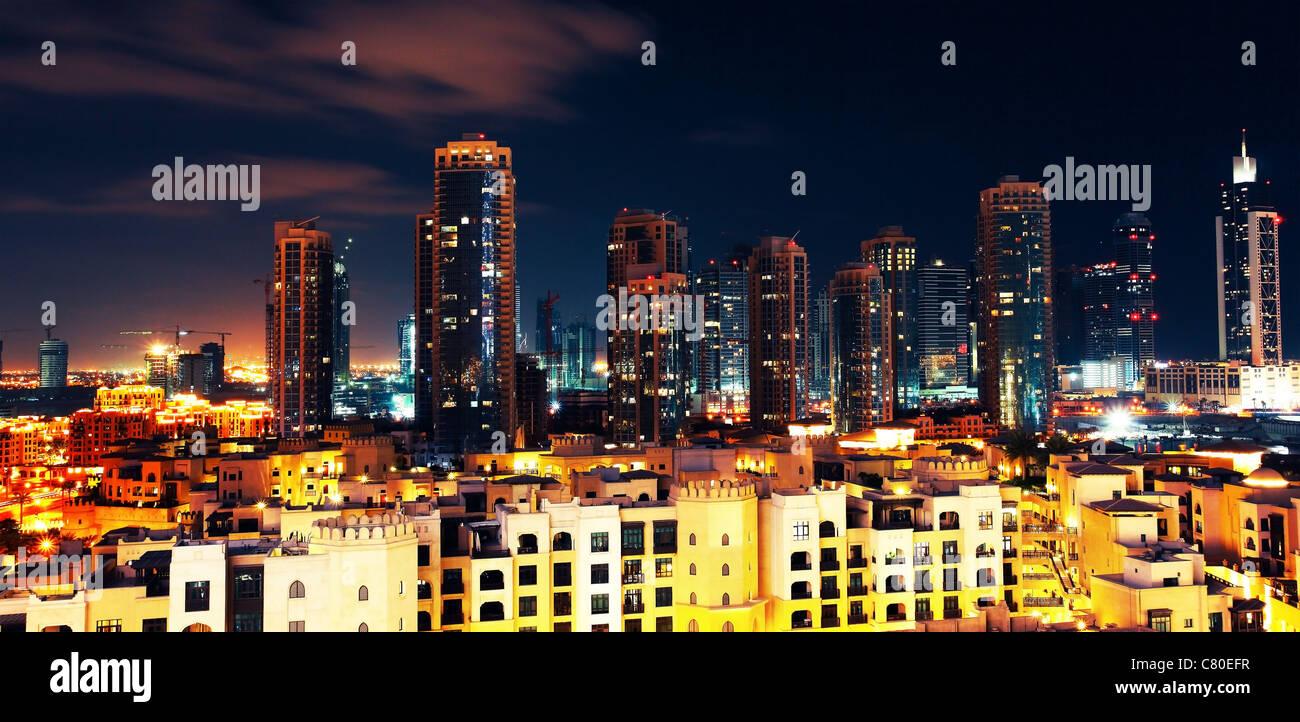 Panoramic image of Dubai downtown at night - Stock Image