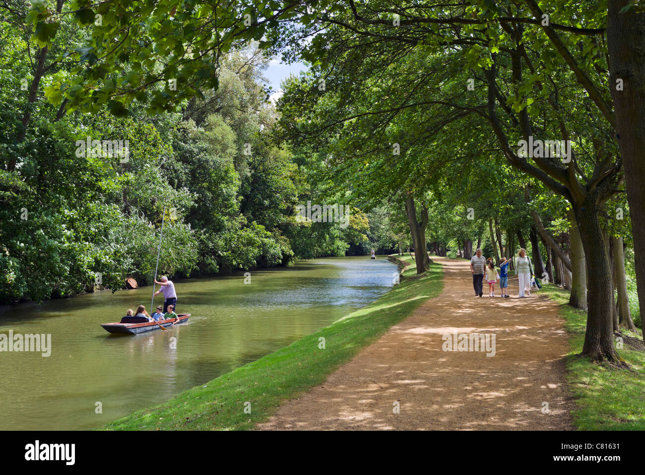Punting on the River Cherwell and walking along its banks near Christ Church Meadow, Oxford, Oxfordshire, England, - Stock Image