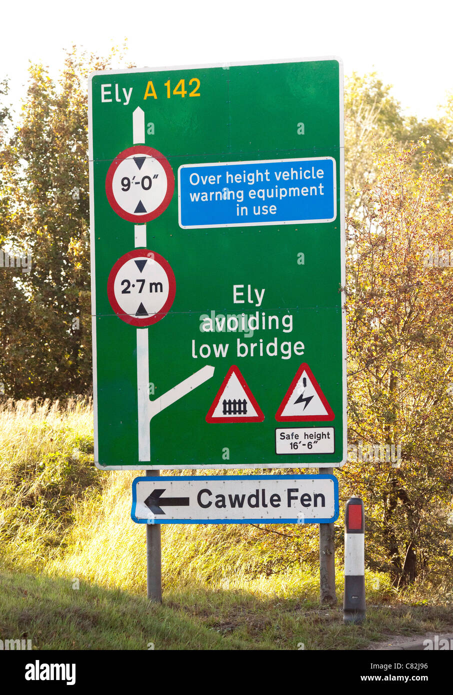 sign warning of height restrictions of low bridge ahead - Stock Image