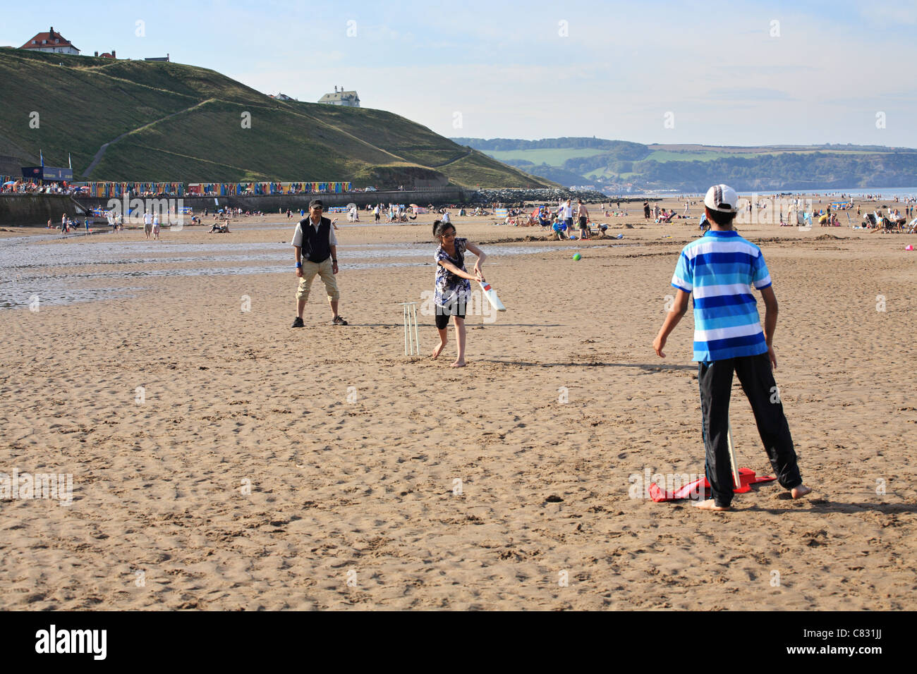 family-of-asian-appearance-playing-cricket-on-the-beach-at-whitby-C831JJ.jpg