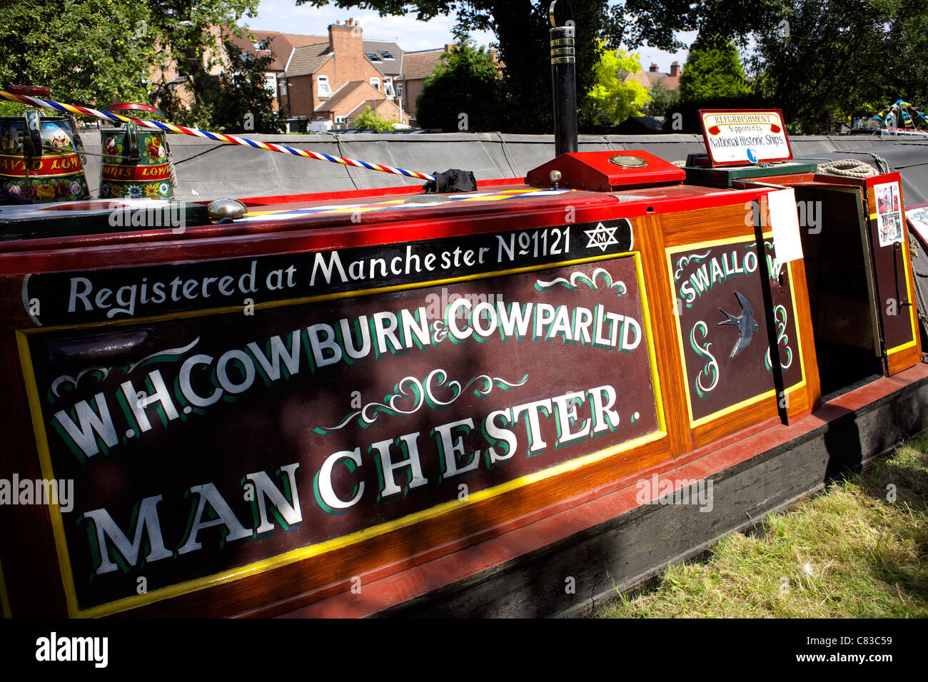 Traditional working narrowboat, Swallow, moored on the Trent and Mersey Canal during the 2011 Inland Waterways Festival - Stock Image