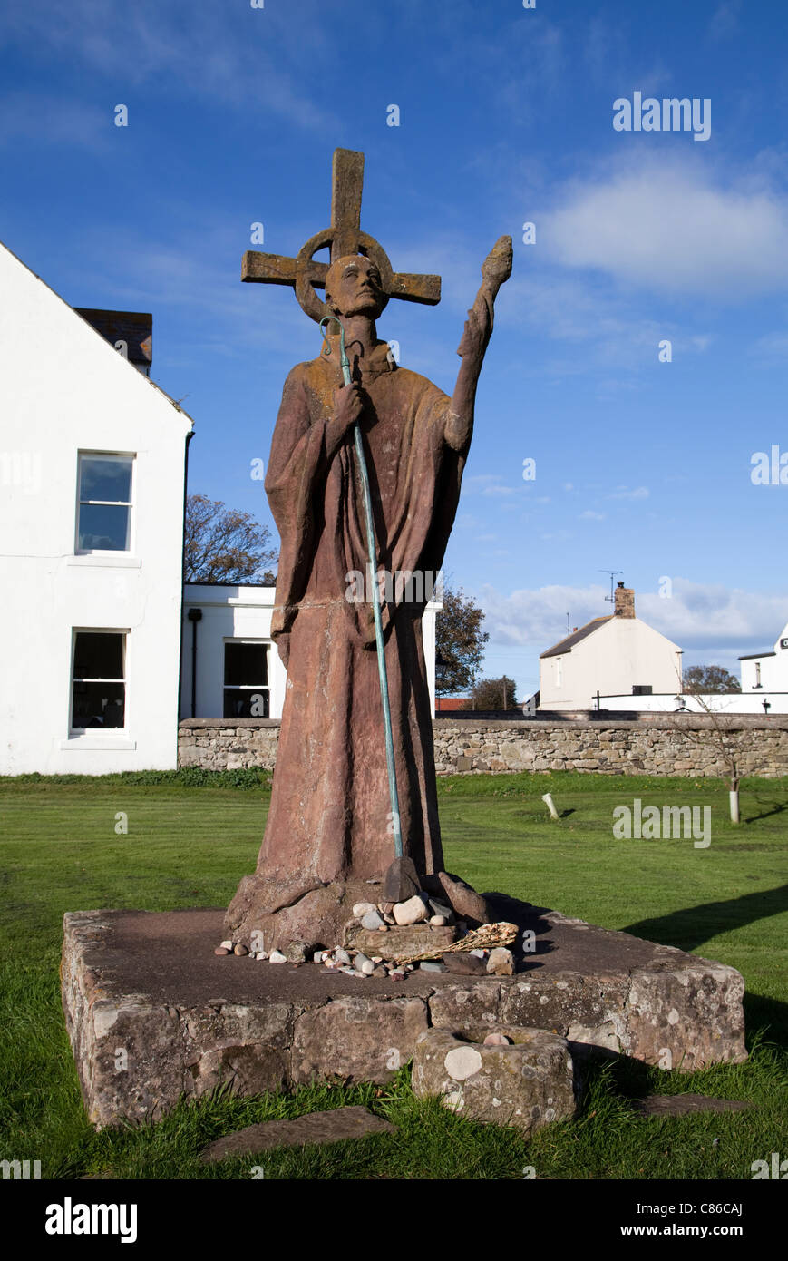 Statue of St. Aidan in St. Mary's Churchyard beside Lindisfarne Priory, Northumberland Stock Photo