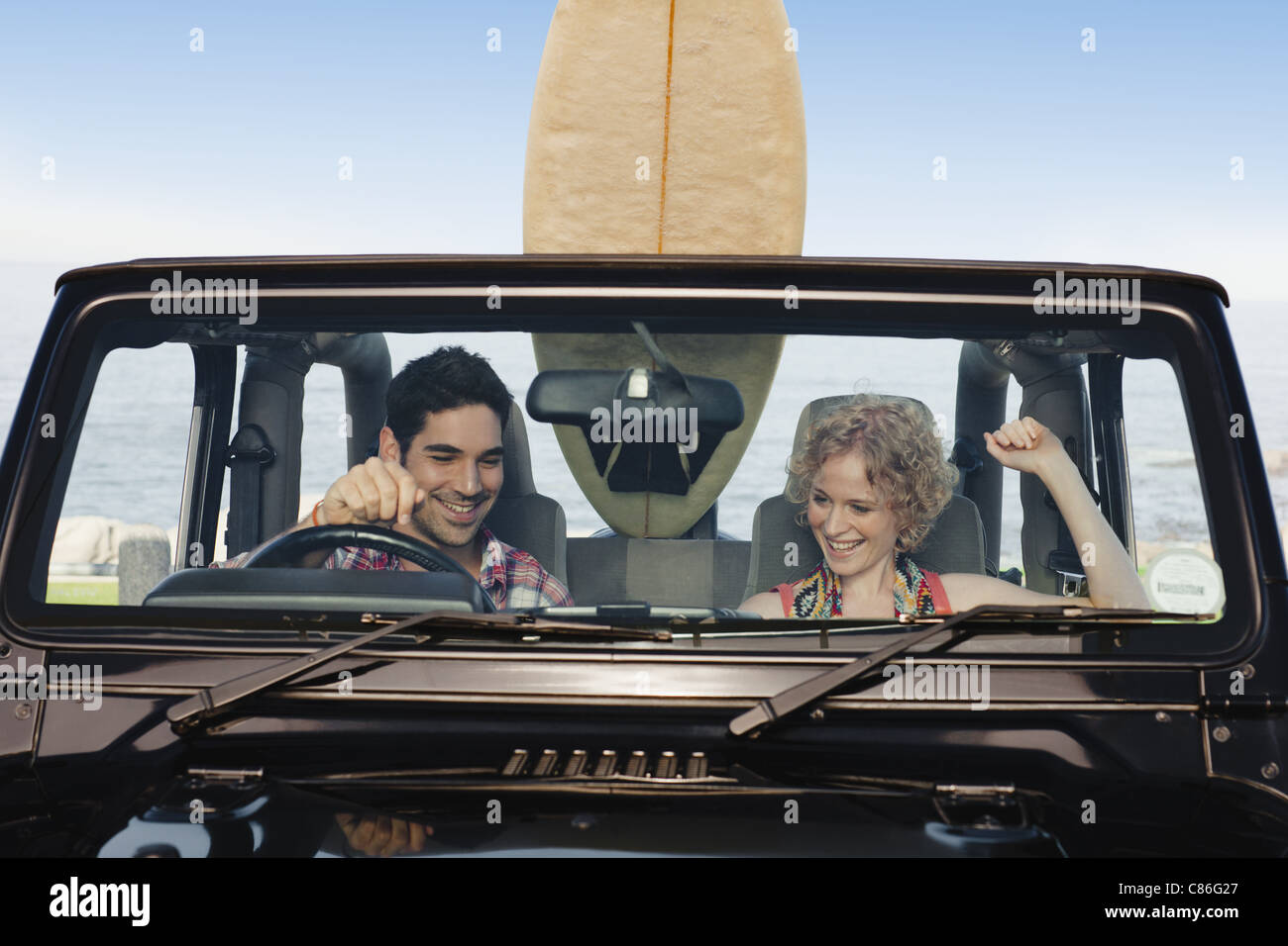 Couple riding in jeep together - Stock Image