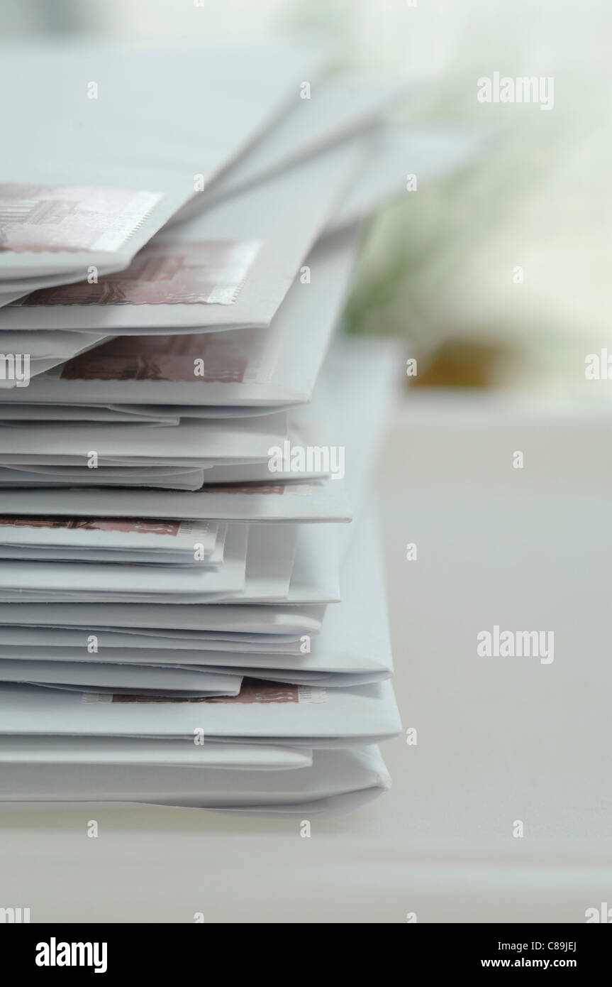 Germany, Stack of letters in envelope at office, close up - Stock Image