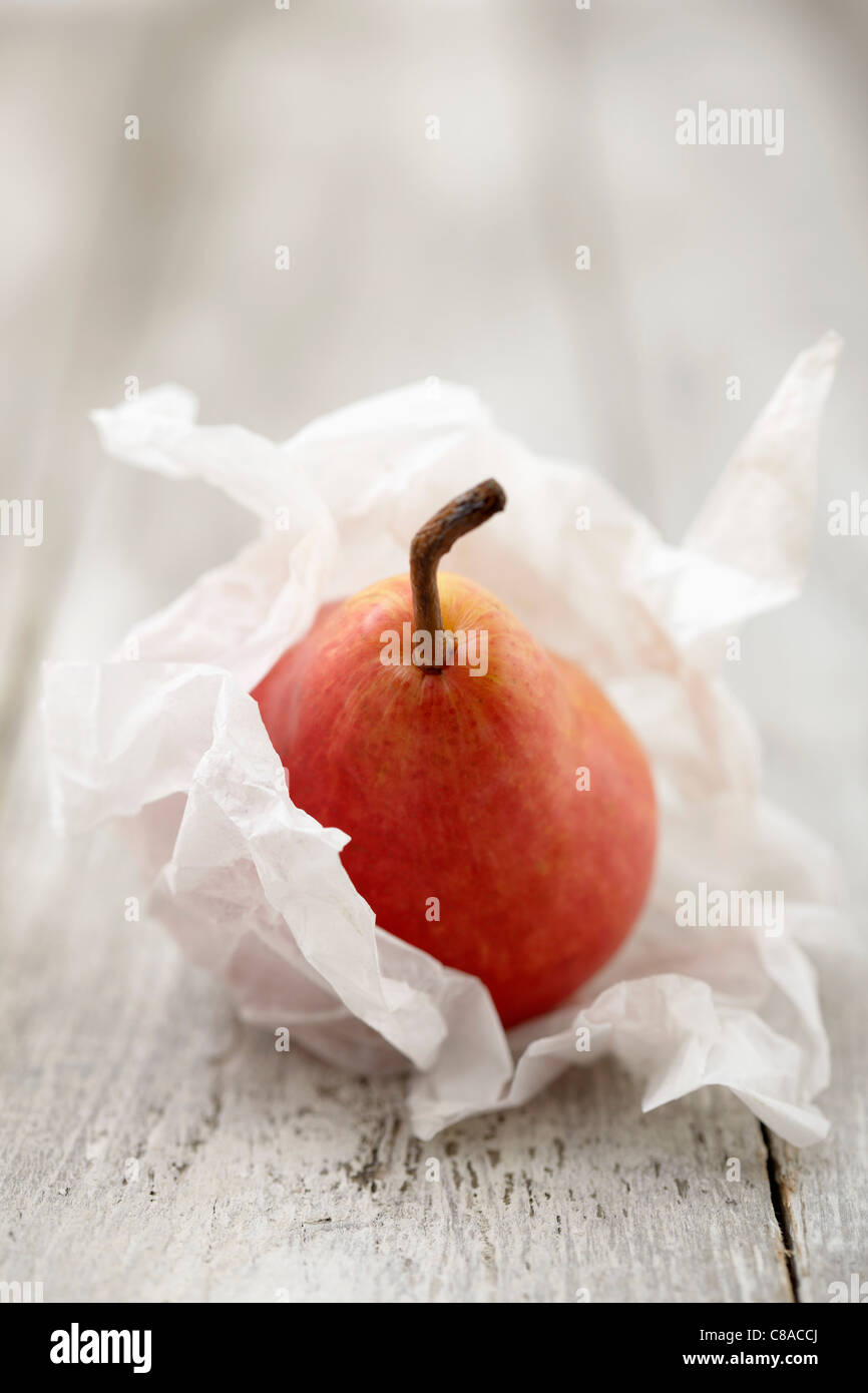 Pear wrapped in silk paper - Stock Image