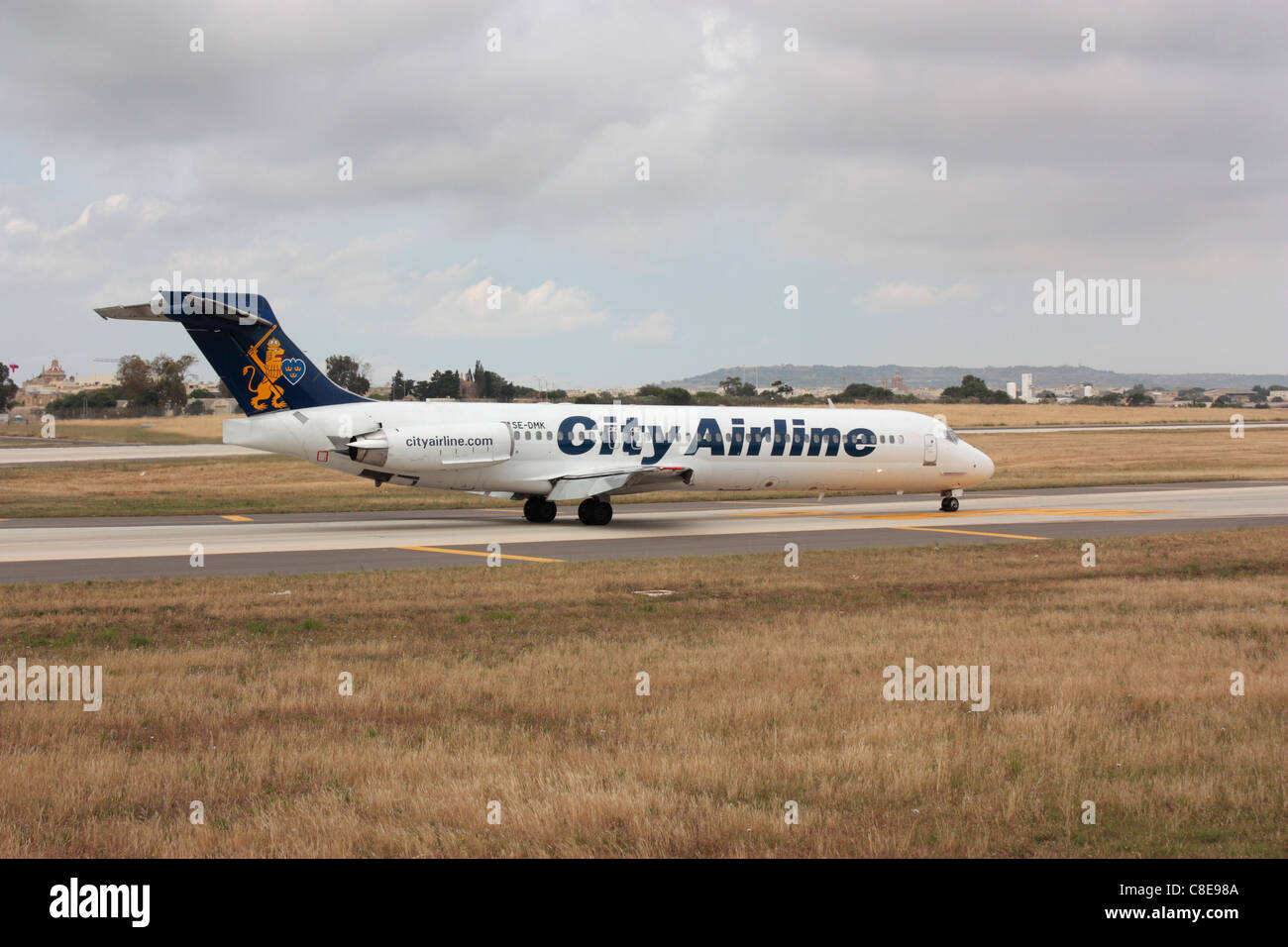 City Airline MD-87 taxiing to the terminal on arrival in Malta - Stock Image