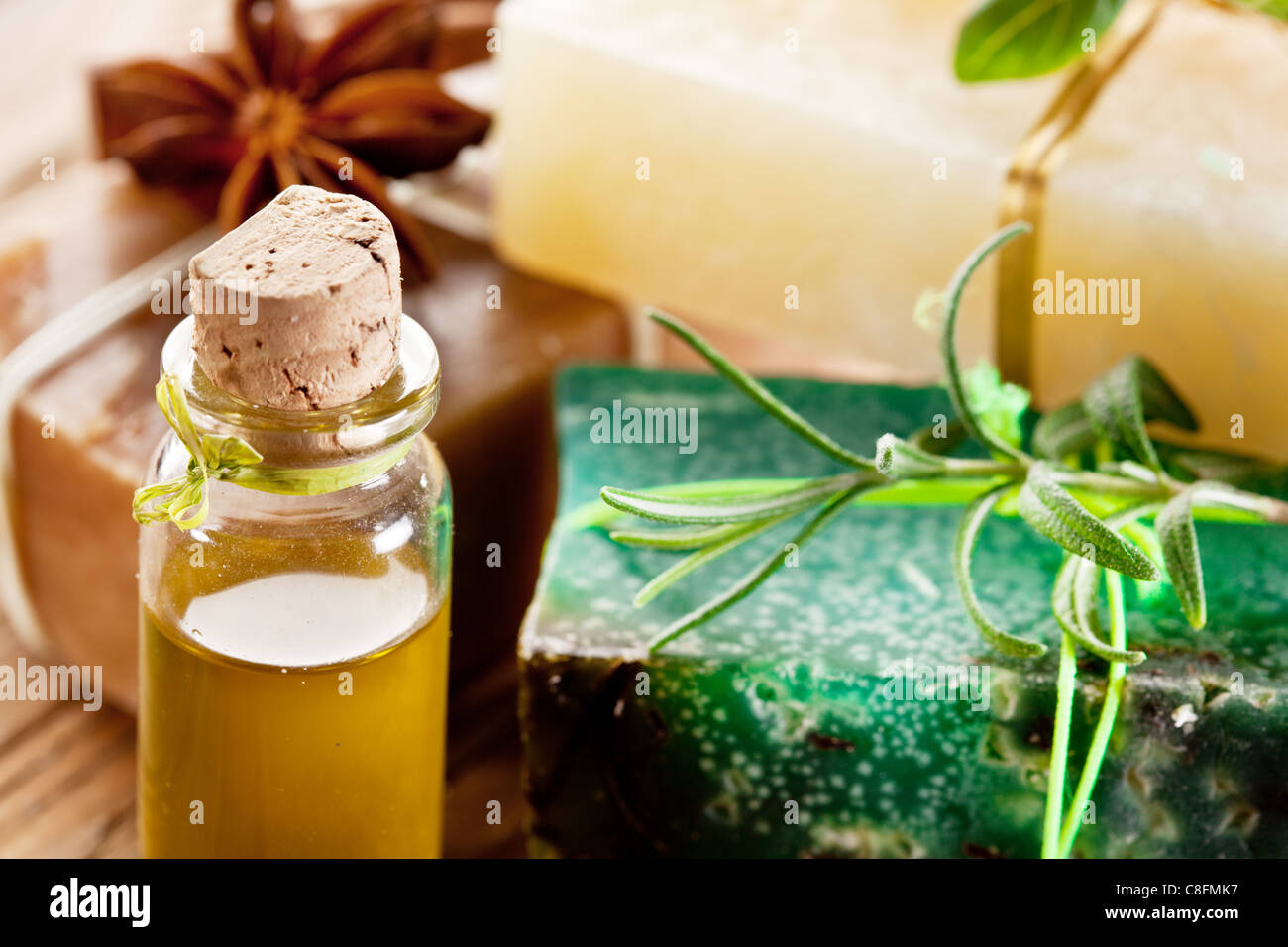 Pieces of natural soap with herb and oil. - Stock Image