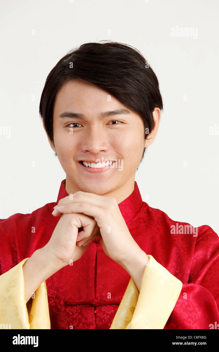 Man in chinese traditional clothes greeting other people chinese new man in chinese traditional clothes greeting other people chinese new year m4hsunfo