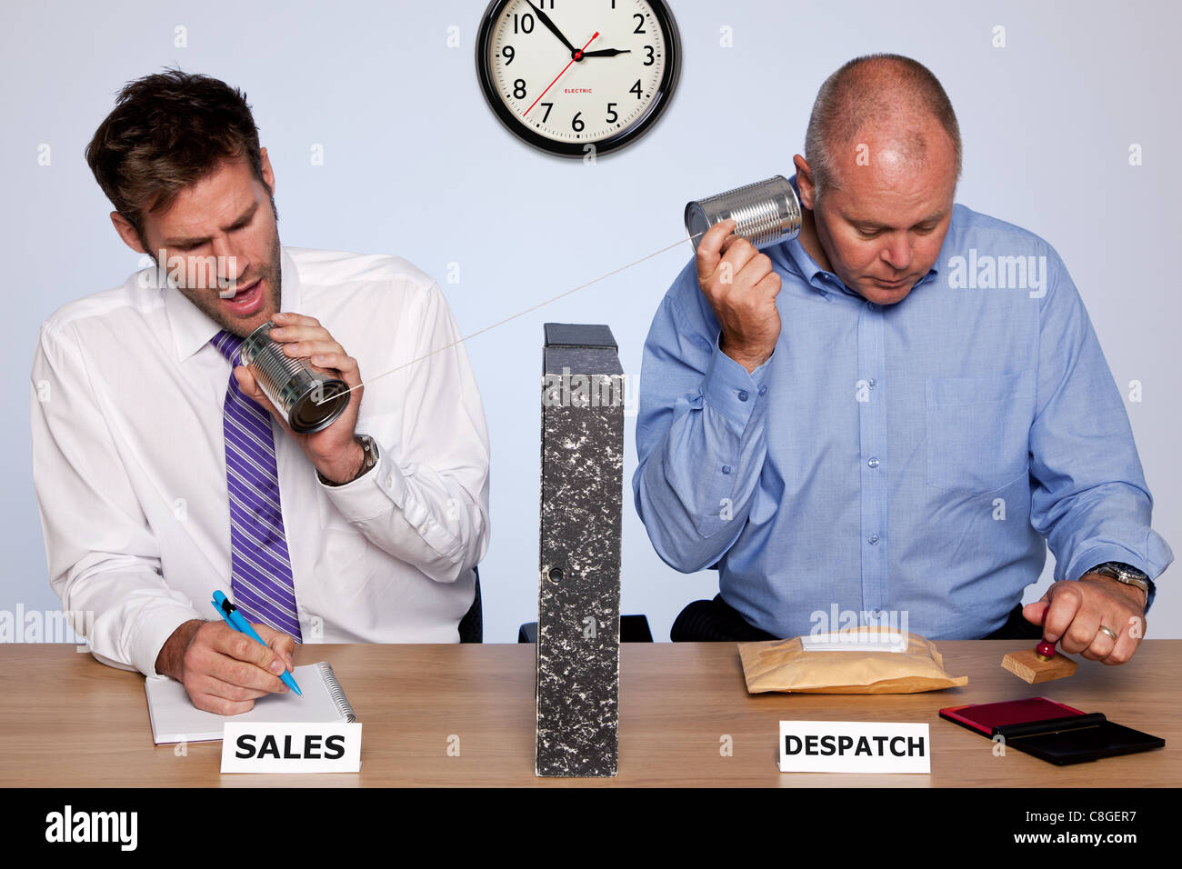 Amusing photo showing the behind the scenes reality of the sales and despatch departments for a small business - Stock Image