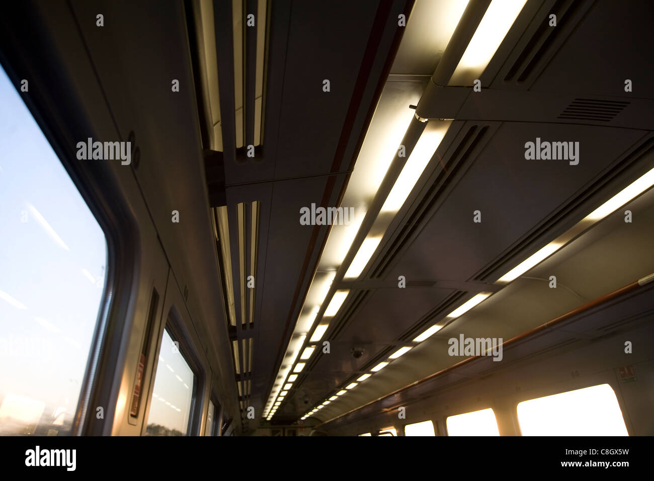 Lights in train carriage motion movement of a journey - Stock Image