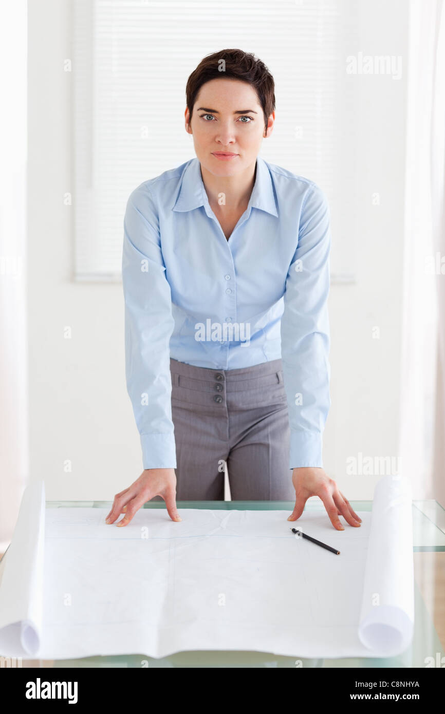 Businesswoman with a architectural plan - Stock Image