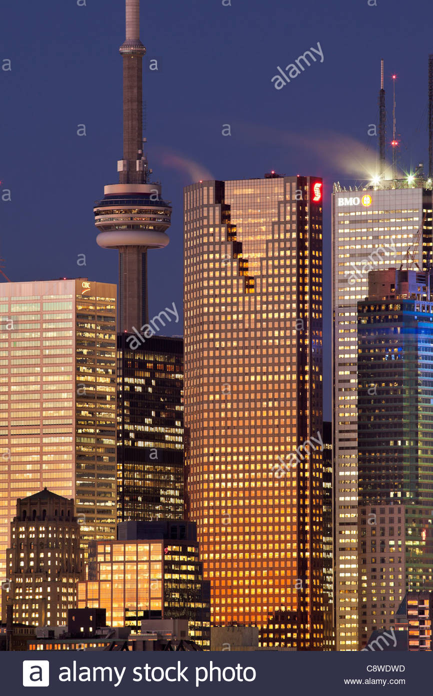 Sunrise glow on the CN Tower and the bank office towers in the downtown financial district of Toronto Ontario Canada - Stock Image