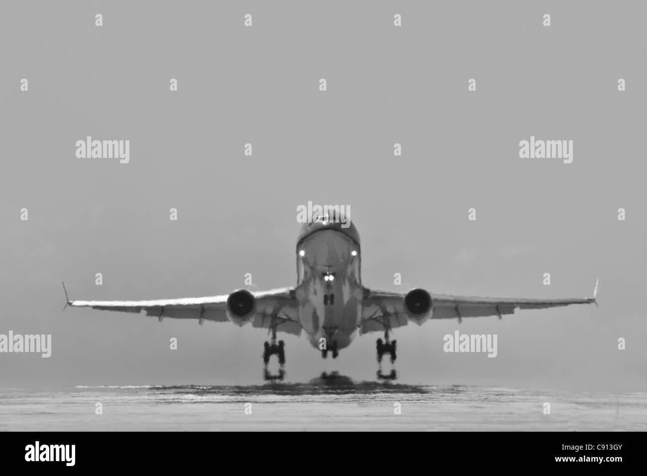 Bonaire Island, Dutch Caribbean, Kralendijk, KLM Douglas DC-10 airplane, taking off from Flamingo Airport. Black - Stock Image
