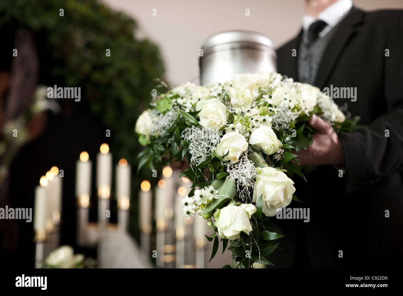Religion, death and dolor  - funeral and cemetery; urn funeral Stock Photo