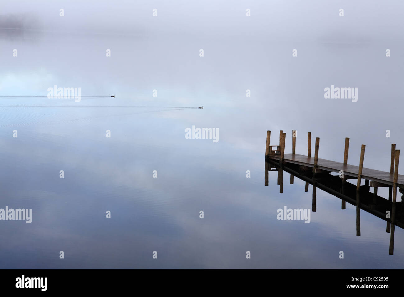 mist-over-derwent-water-with-a-wooden-je