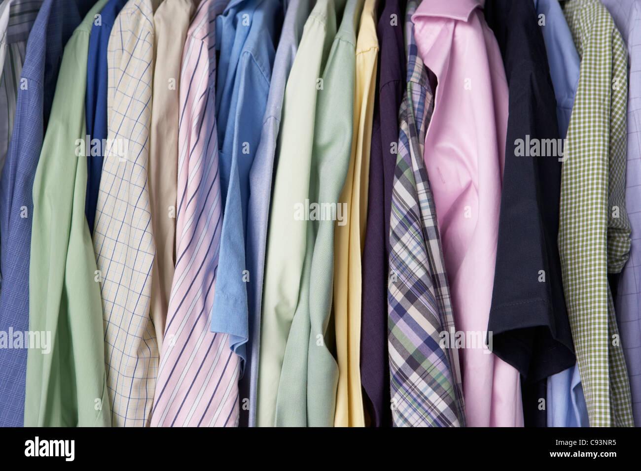 Rail of men's shirts - Stock Image
