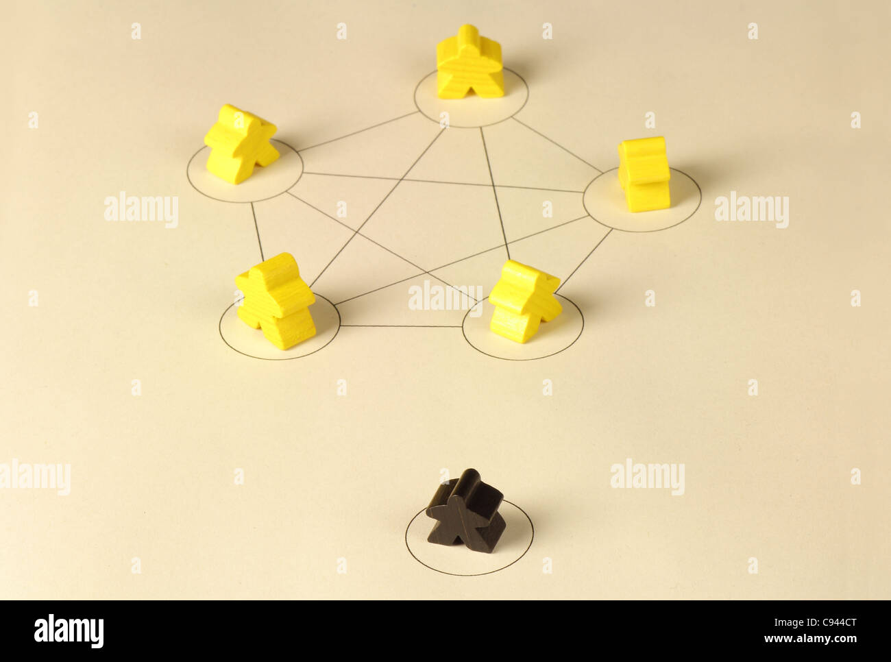 Mobbing within a team, little playing figures, black - Stock Image
