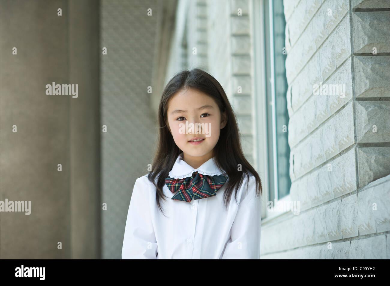 Asian Schoolgirl In School Uniform