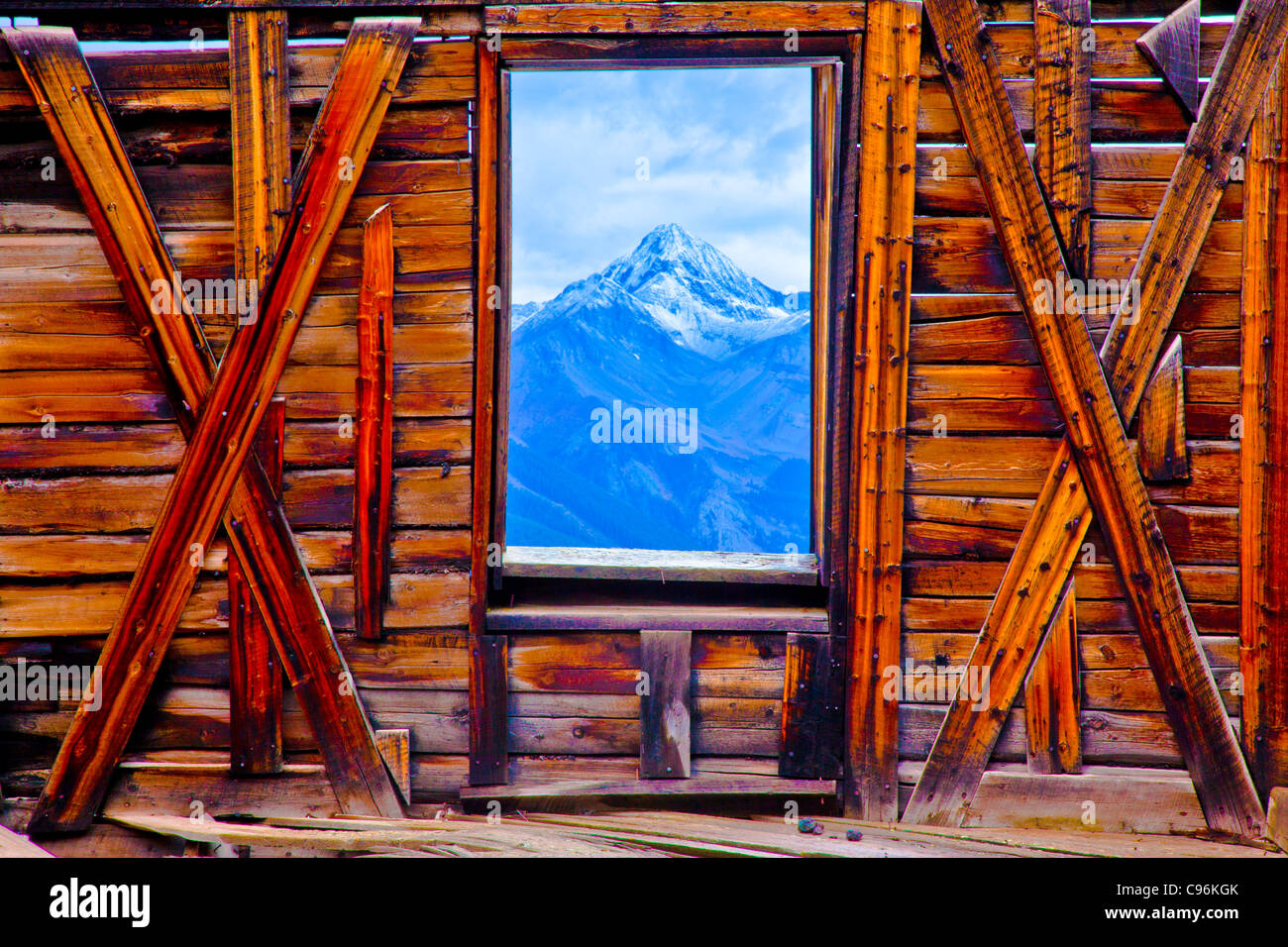 Wilson Peak seen through ghost town window, Alta Ghost Town, Colorado, Uncompahgre National Forest, San Juan Mountains - Stock Image
