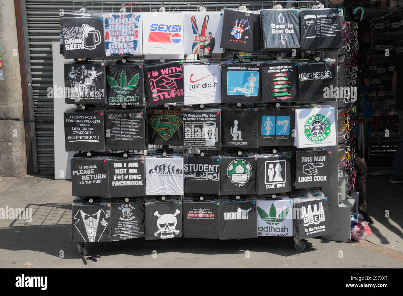 A Rack Of Rude, Cheap T Shirts Outside A Fashion Store On Camden High  Street, Near Camden Market, In Camden Town, London, UK