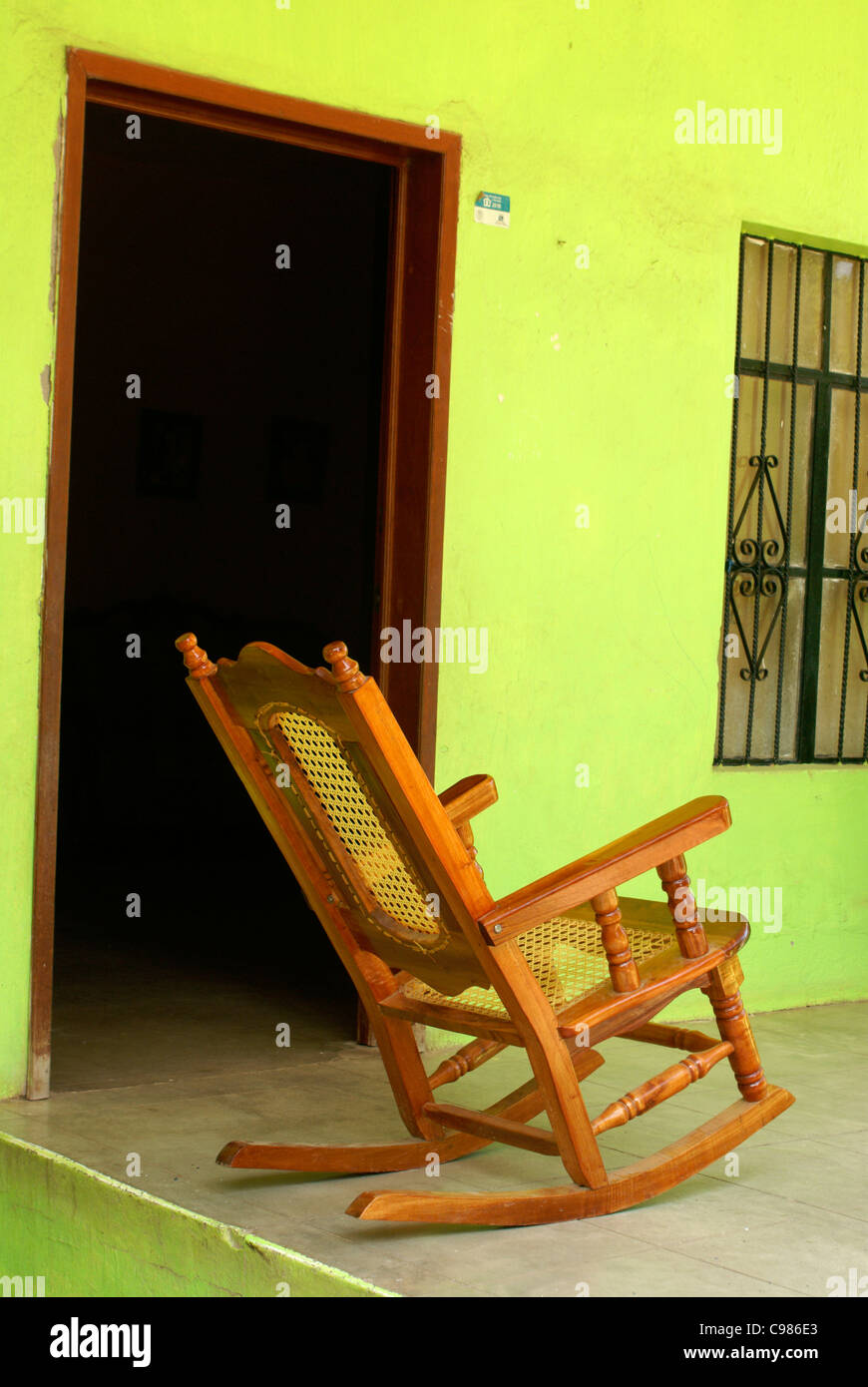 rocking-chair-on-the-porch-of-a-house-in-the-town-of-el-quelite-near-C986E3.jpg