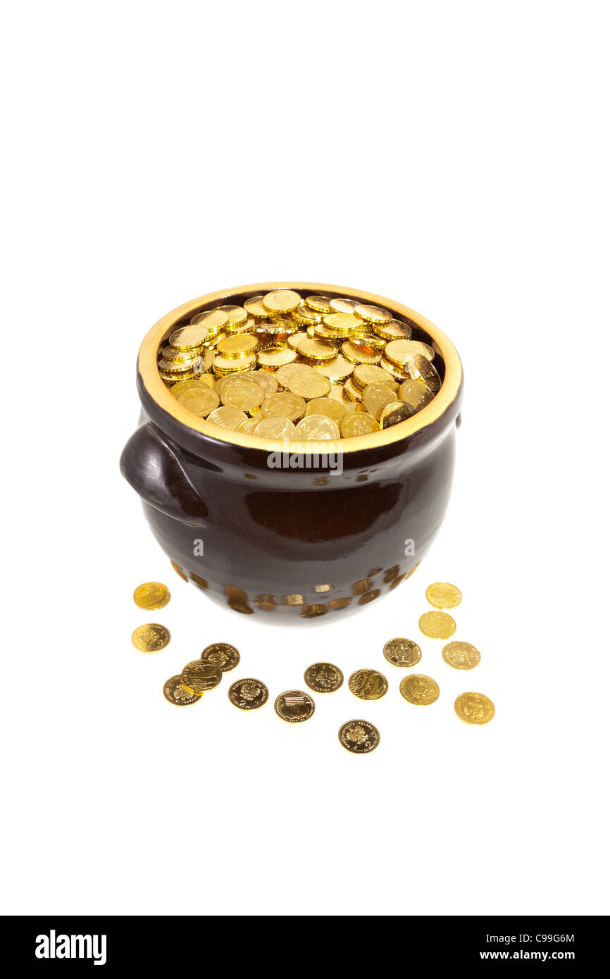 Pot of gold coins isolate on a white background. - Stock Image