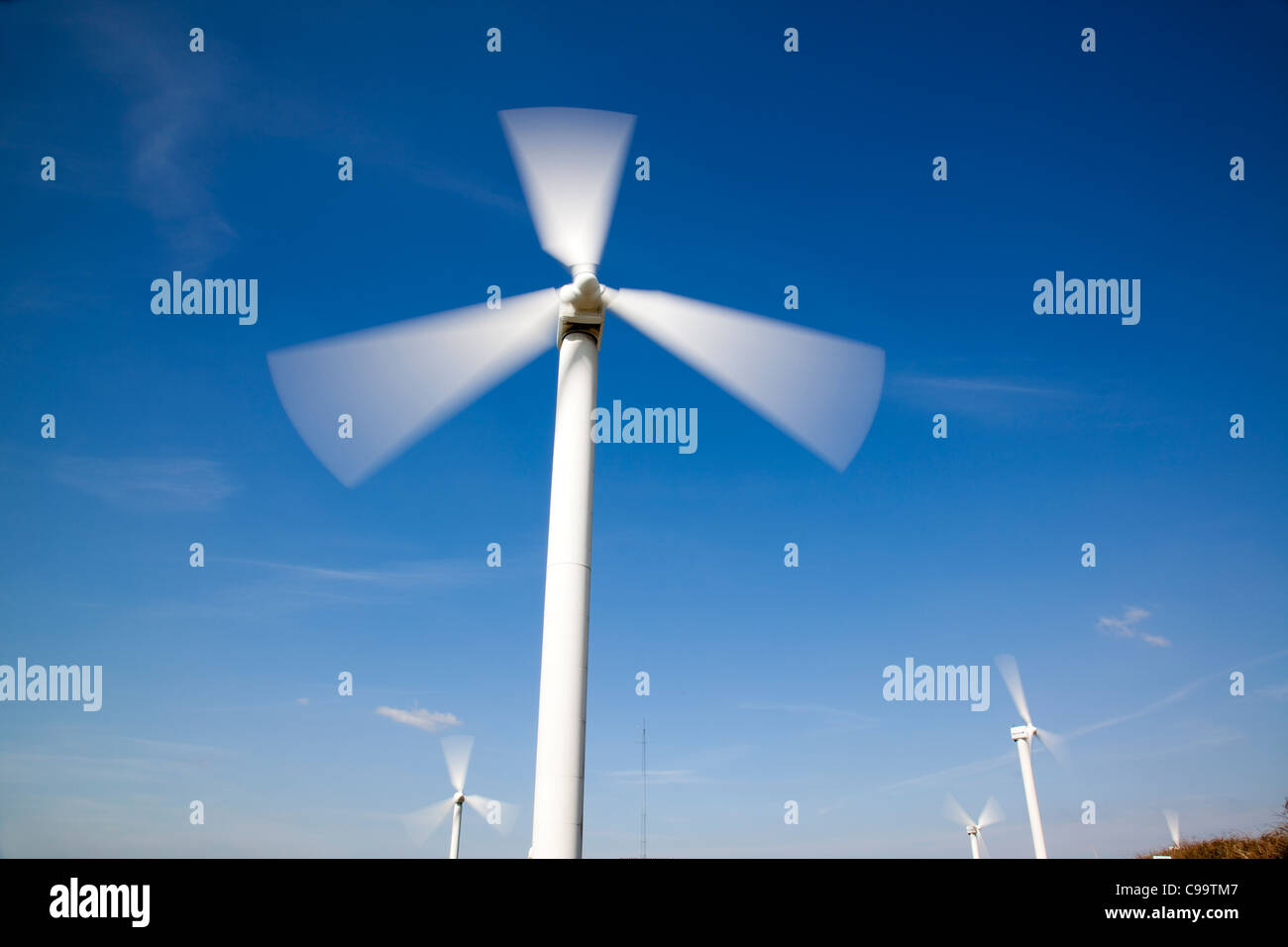 Wind Farm, Wind Turbine against blue sky - Stock Image