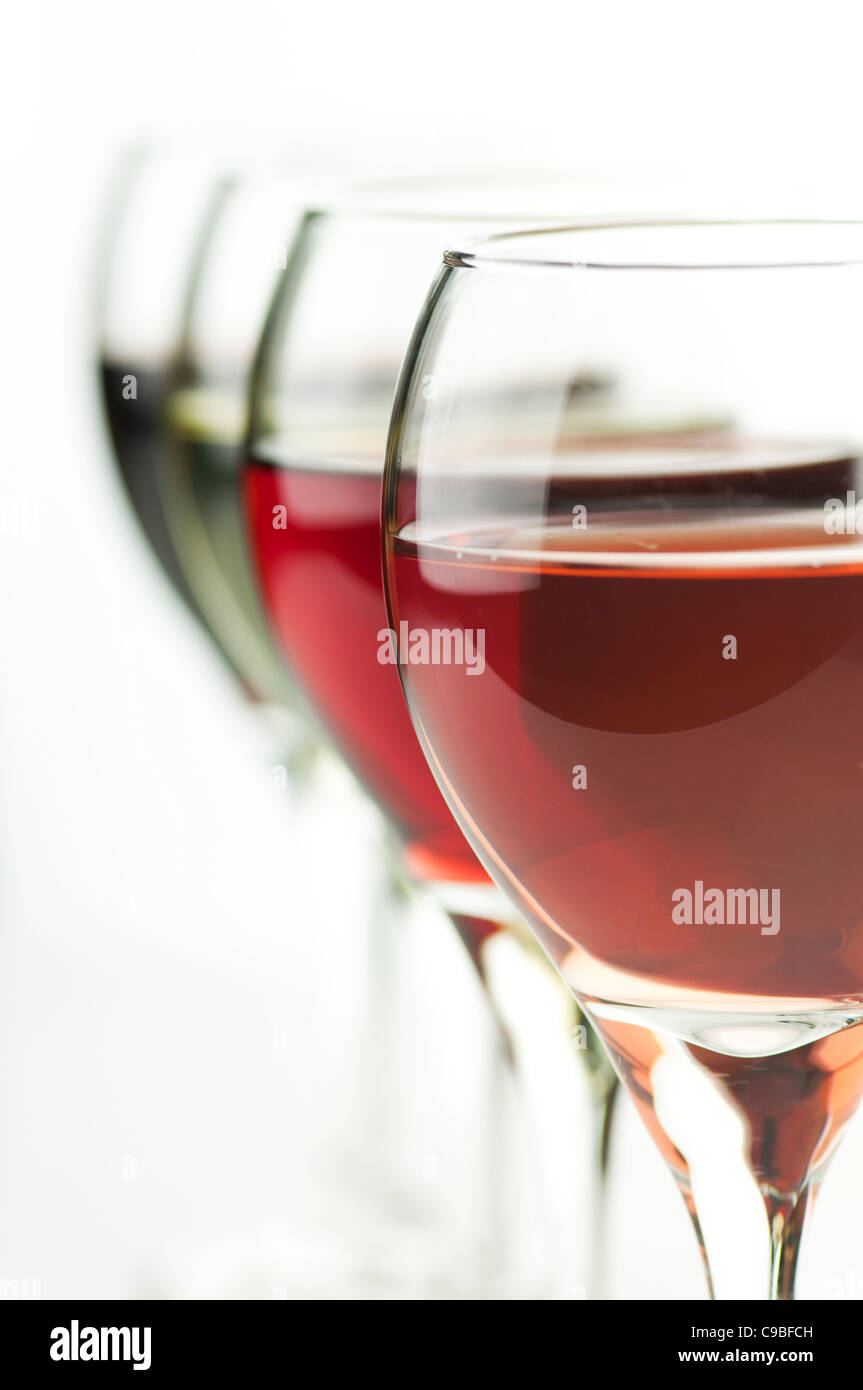 glasses of pink , red and white wine , close up shot - Stock Image