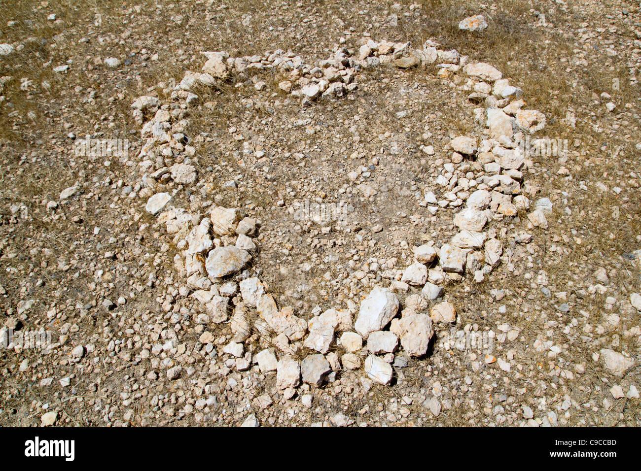 Heart shape symbol of stones like a love metaphor sign - Stock Image