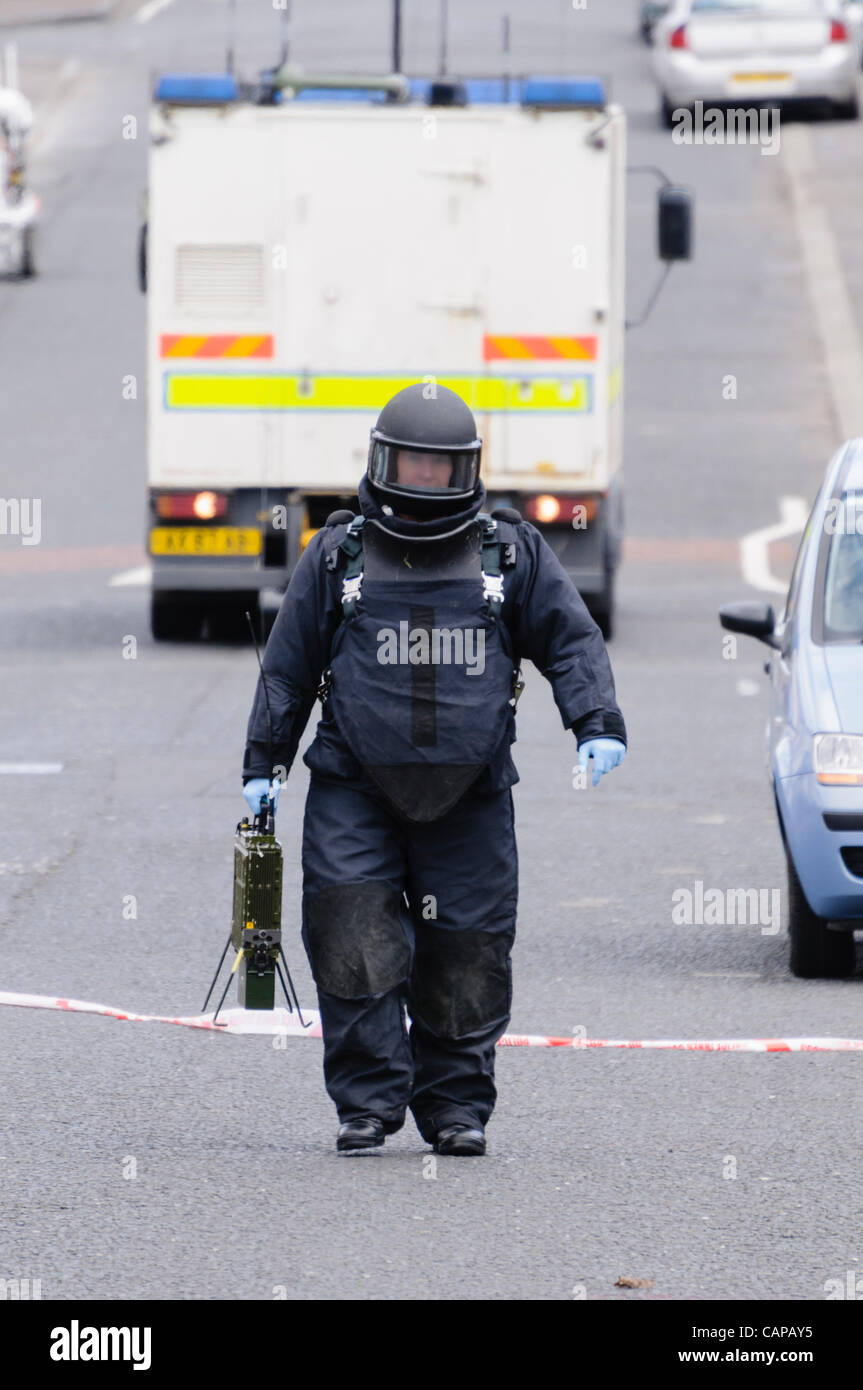 Belfast, UK. 05/04/2012 - Ammuntion Technical Officer walks to a suspicious device during a security alert in Ardoyne. - Stock Image
