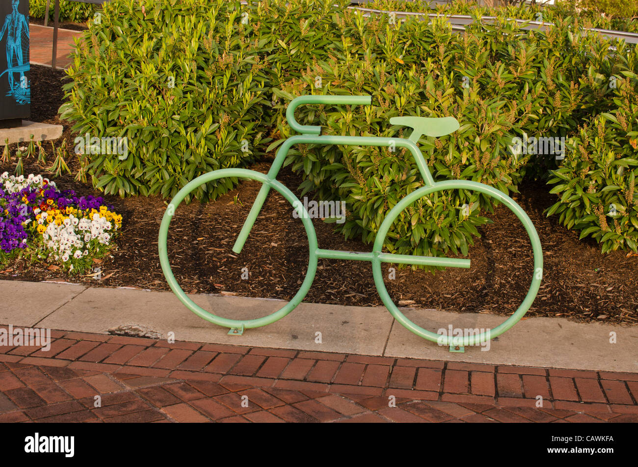 cleverly-designed-bike-rack-in-shape-of-a-bicycle-along-the-bike-jogging-CAWKFA.jpg