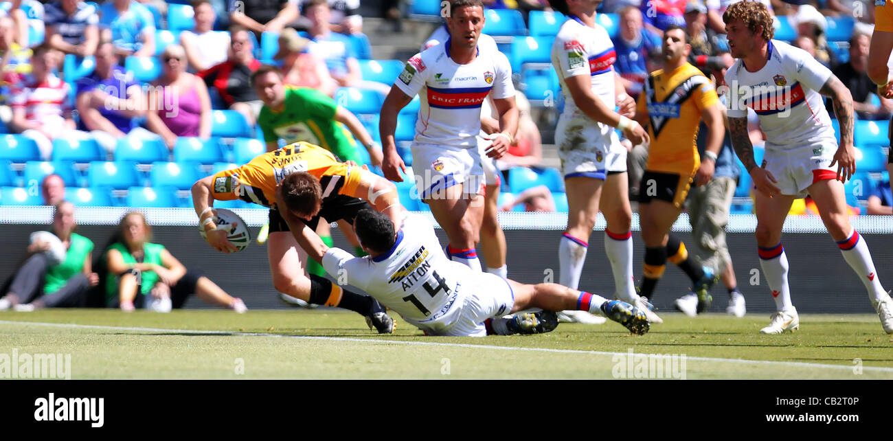 26.05.2012 Manchester, England. Castleford v Wakefield. Castleford Tigers Second Row Stuart Jones    is brought - Stock Image