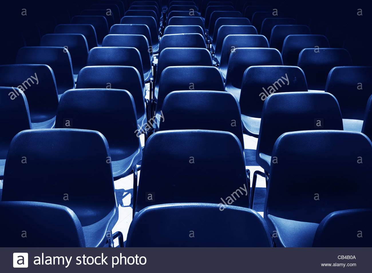 empty blue chairs - Stock Image