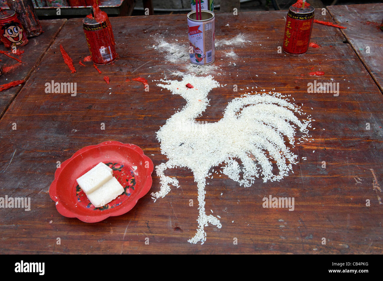 Rooster - a symbolic animal of the birth year - made with rice at a Taoist temple during Xiayuan Festival in China. - Stock Image