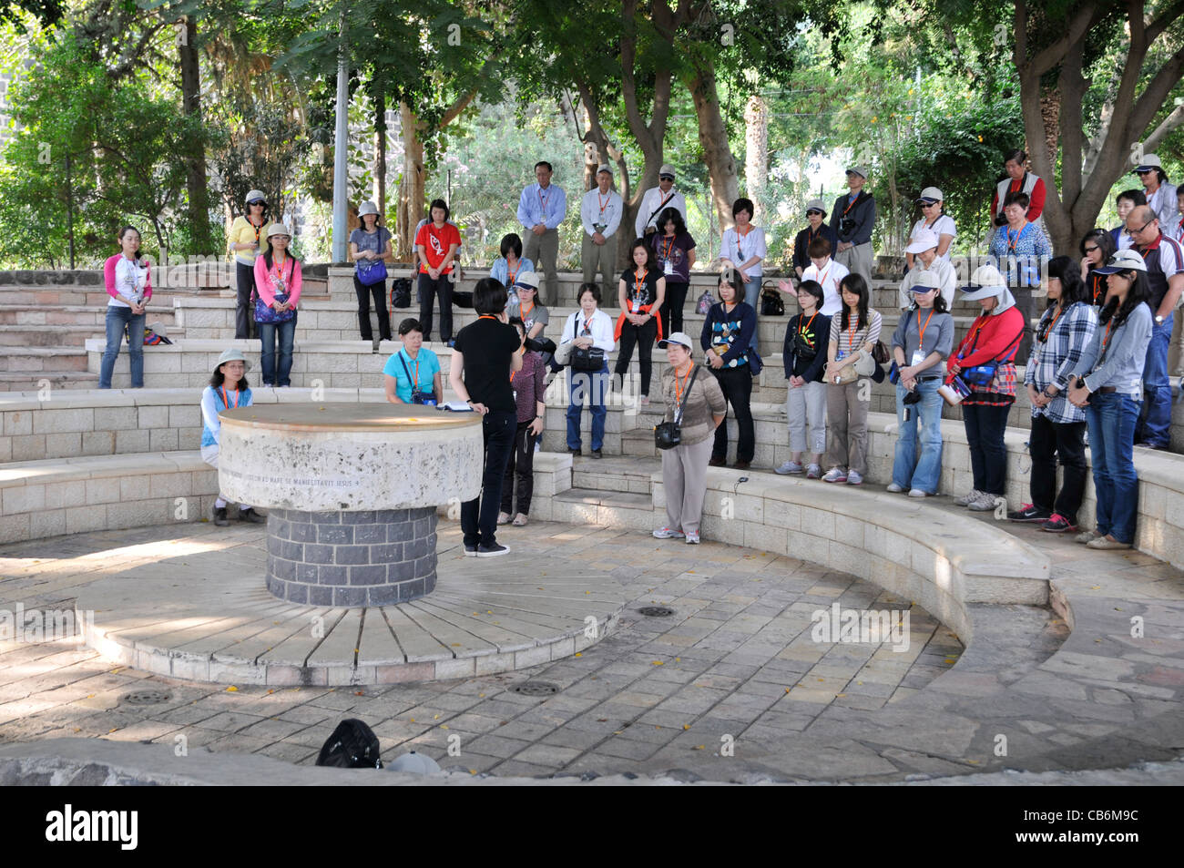 Pilgrims praying near Church of the Primacy of Peter in Tabgha,Galilee, Israel,Asia, Middle East - Stock Image