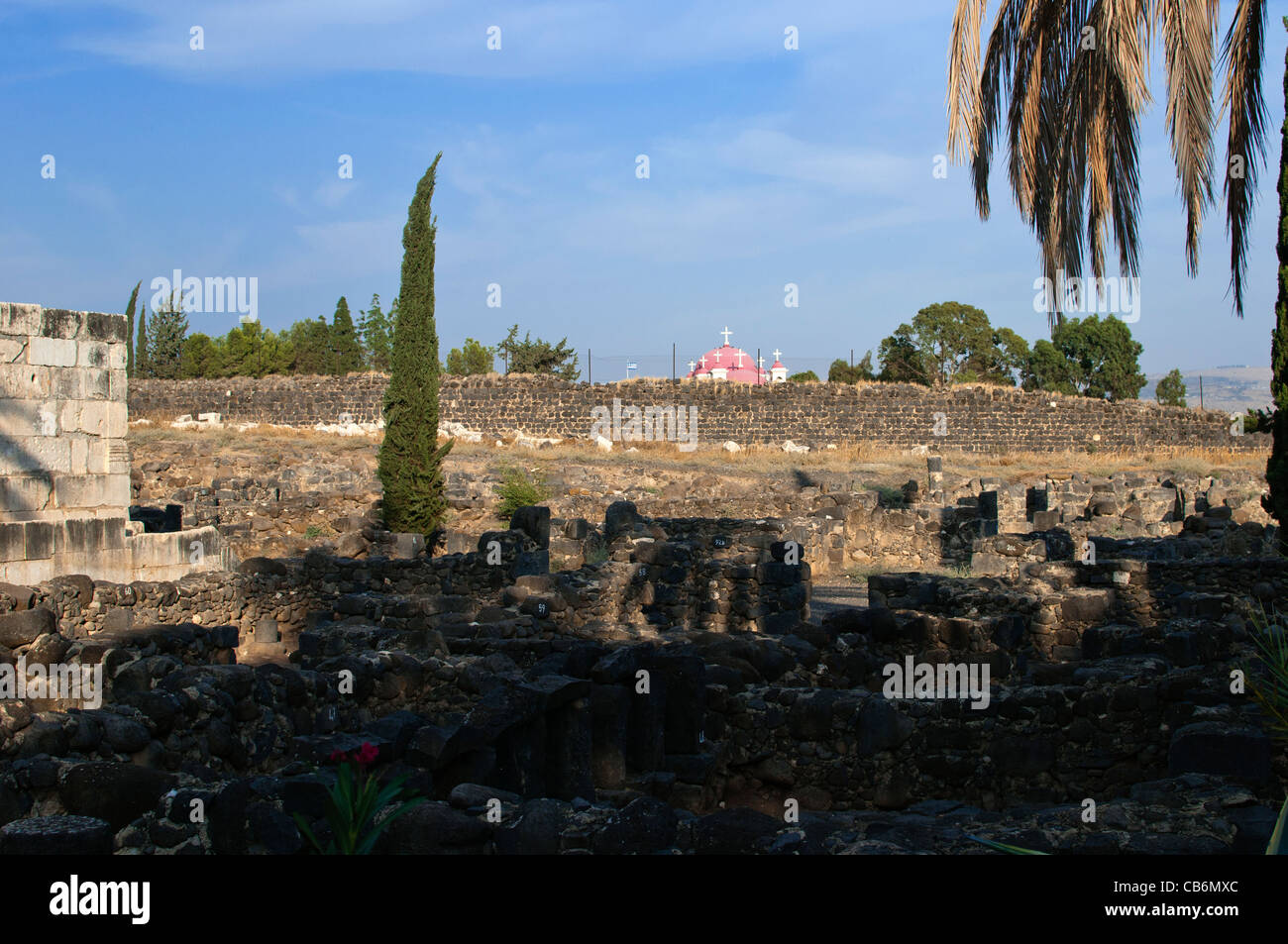 Capernaum ruins with view Greek Orthodox Church in the distance,Galilee, Israel,Asia, Middle East - Stock Image