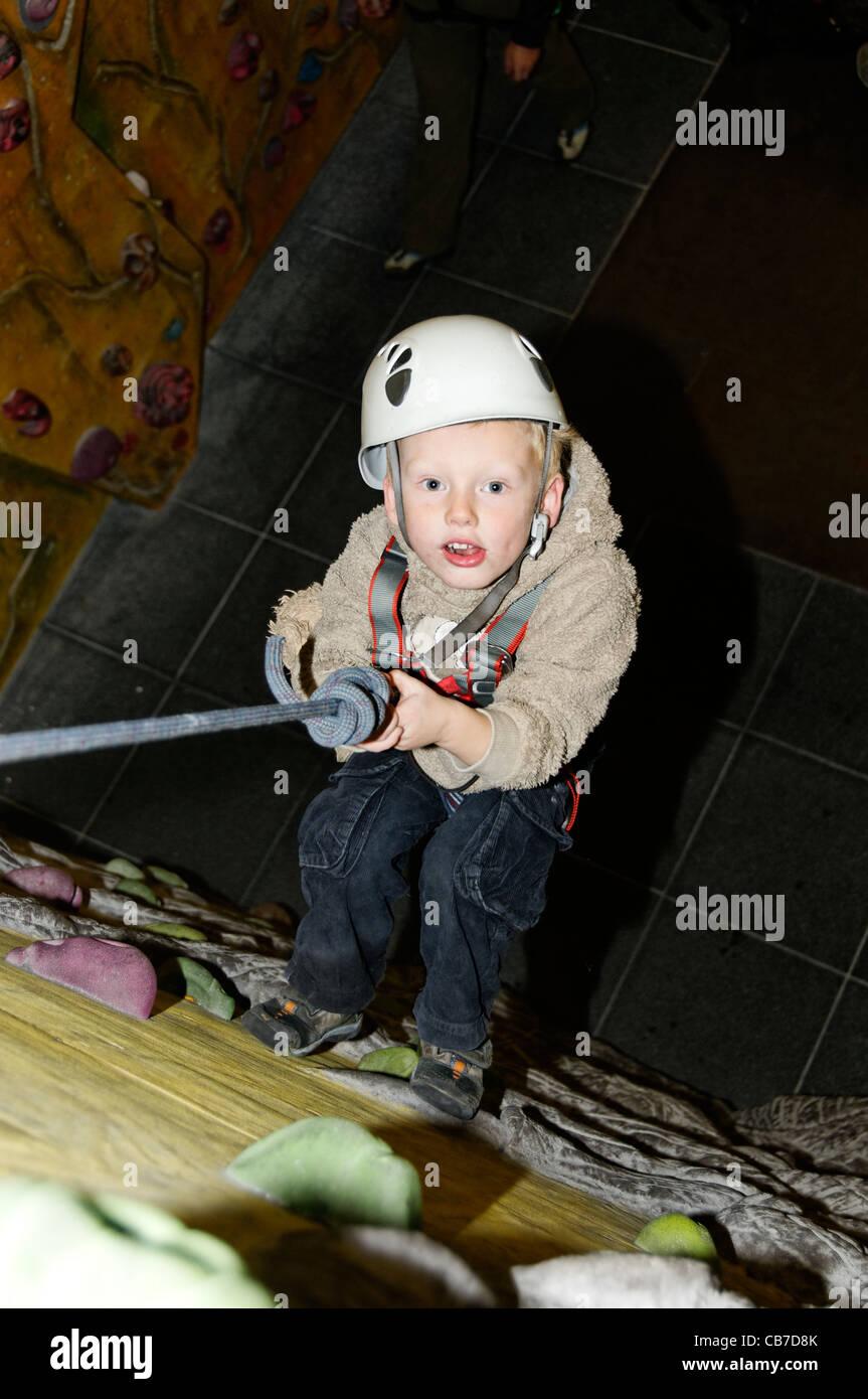 A young boy at the Beacon Climbing Wall - Stock Image