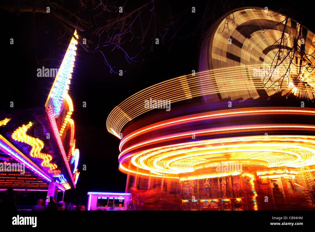 carousel in motion at night - Stock Image