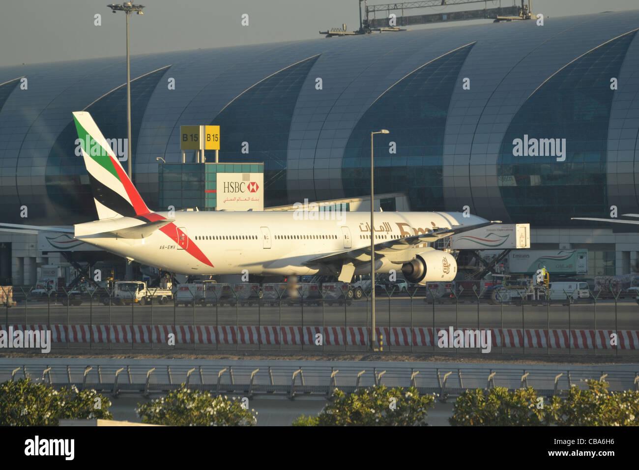 Emirates aircraft parked at Dubai International Airport, UAE - Stock Image