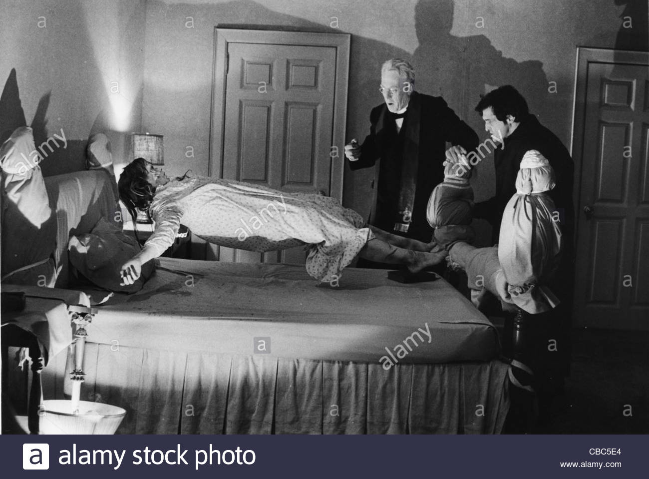"Linda Blair, Max von Sydow and Jason Miller in a scene from the 1973 film ""The Exorcist"", directed by William Friedkin. Stock Photo"