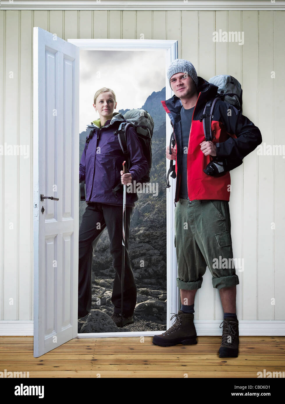 Hikers standing in new house - Stock Image