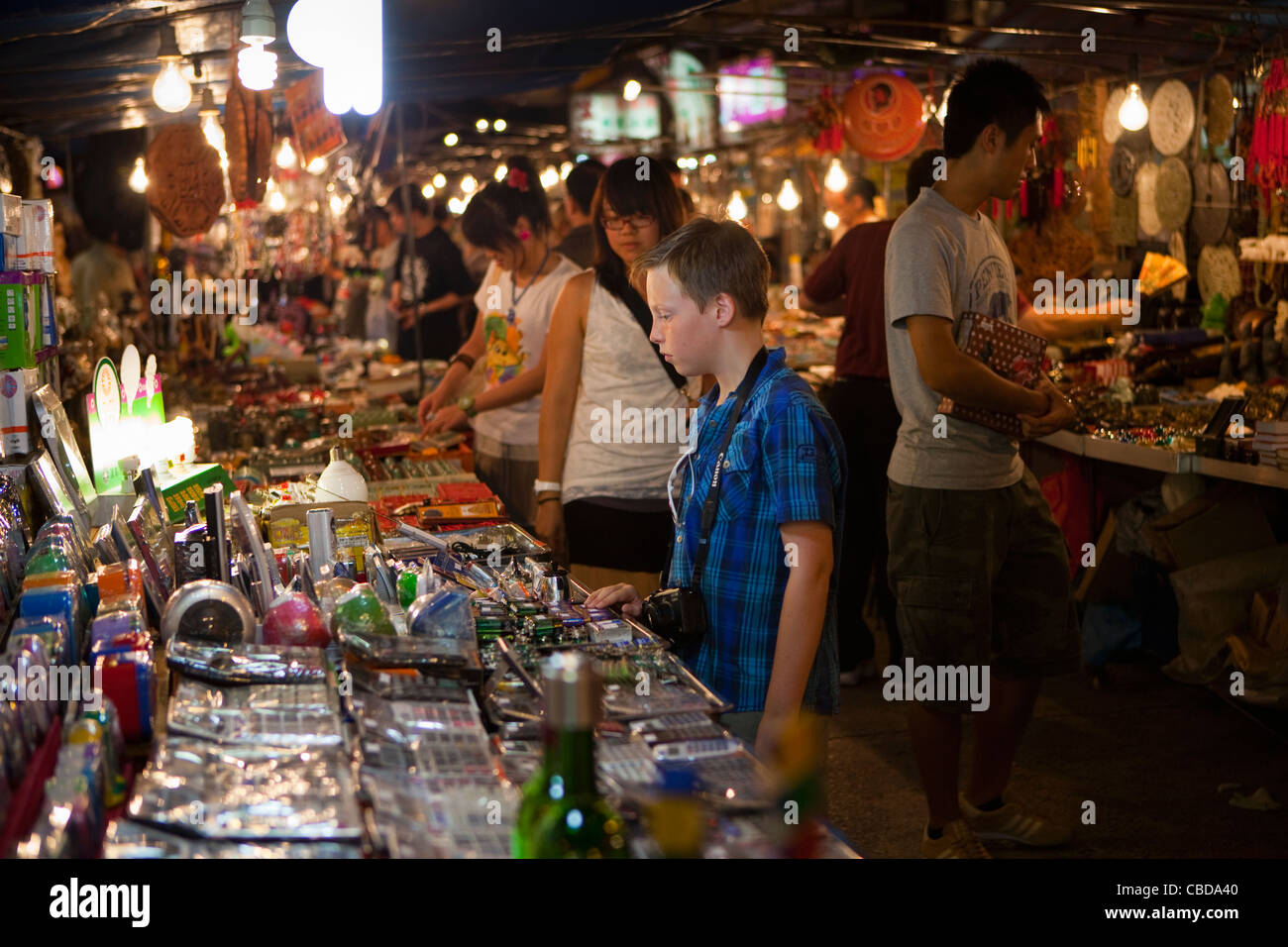 Young Boy shopping at Temple Street Night Market Stock Photo
