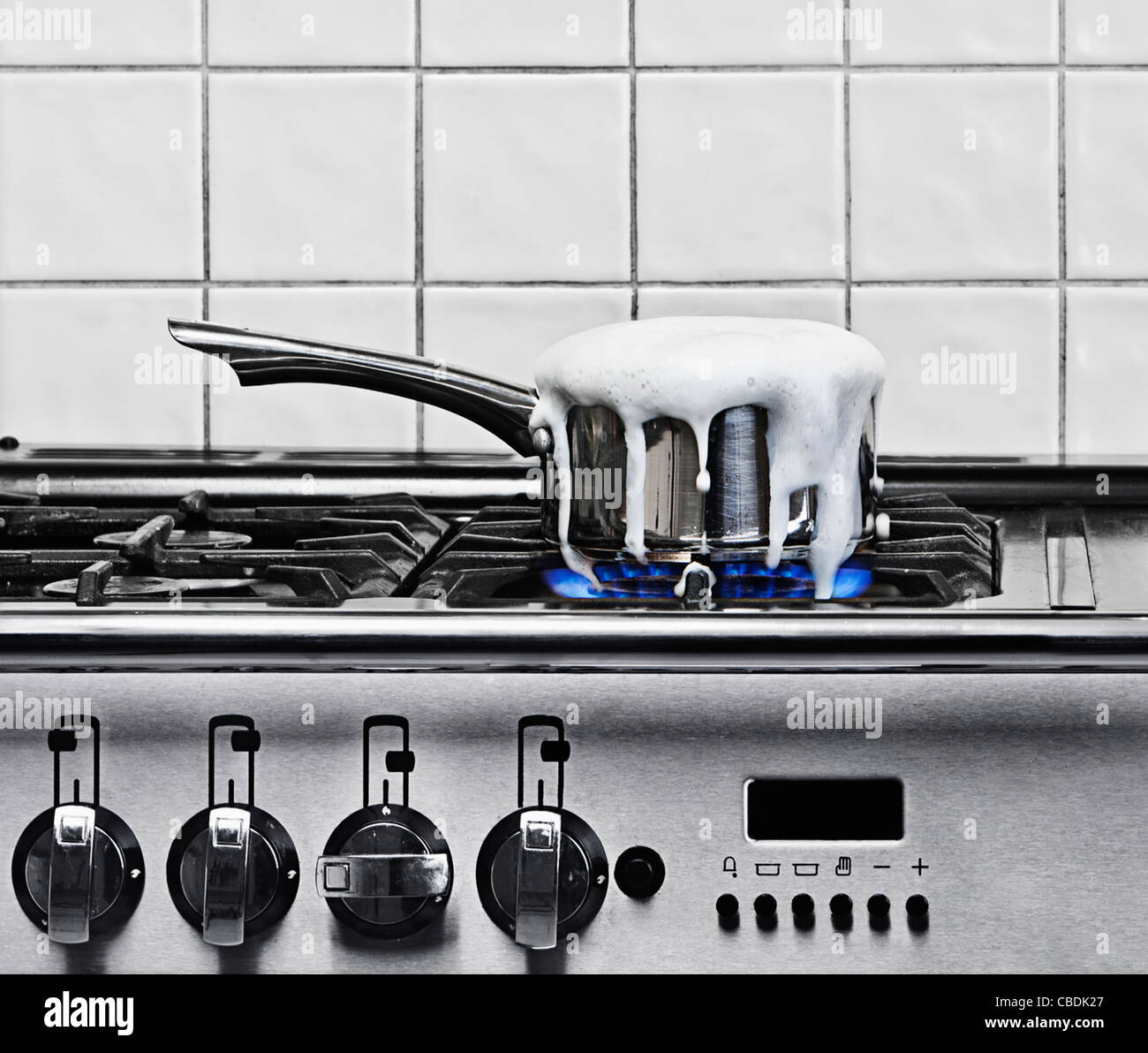 Pan Boiling Over on Gas Hob - Stock Image