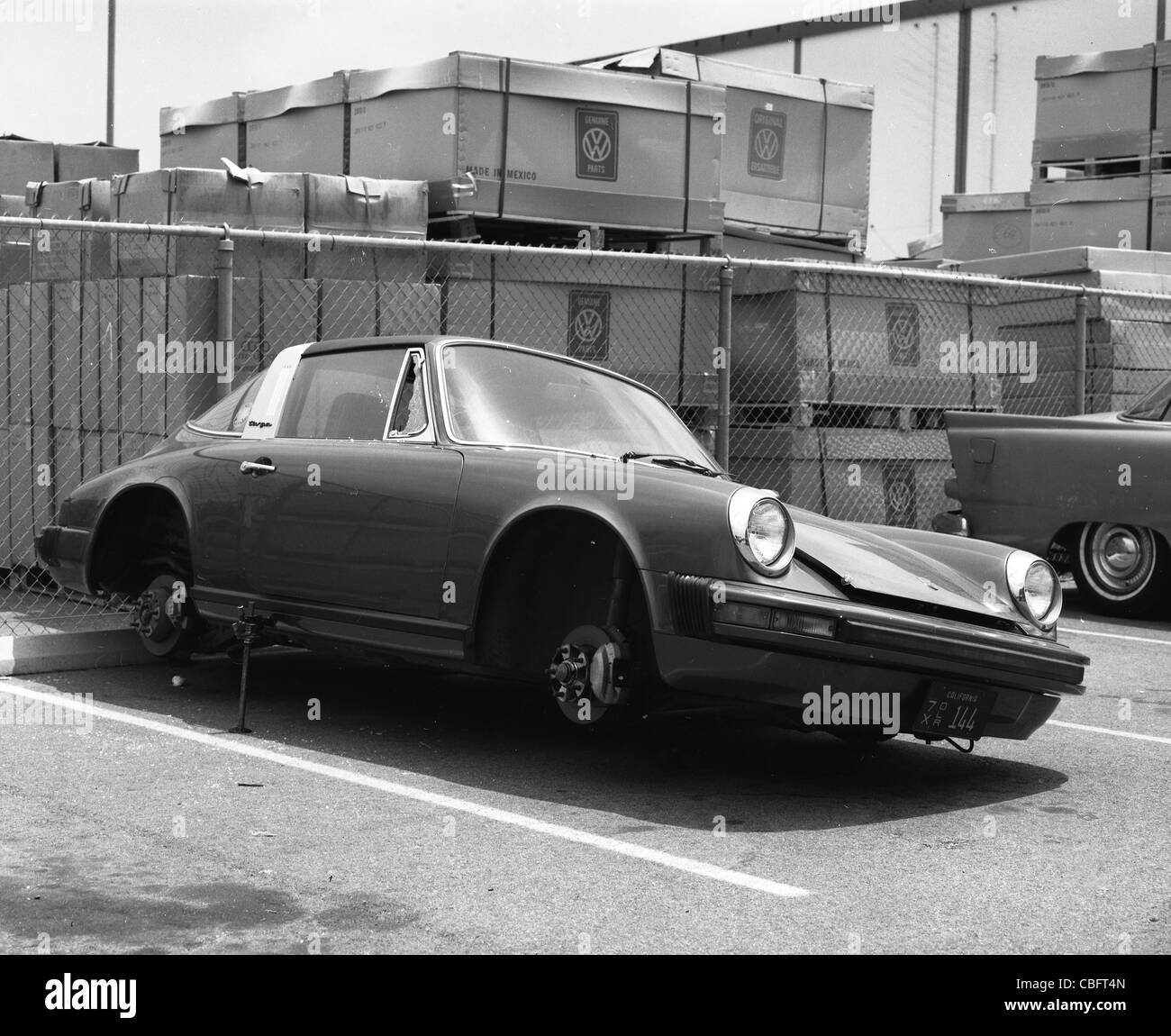 porsche carrera 1970s model parked with wheels missing german sports car - Stock Image