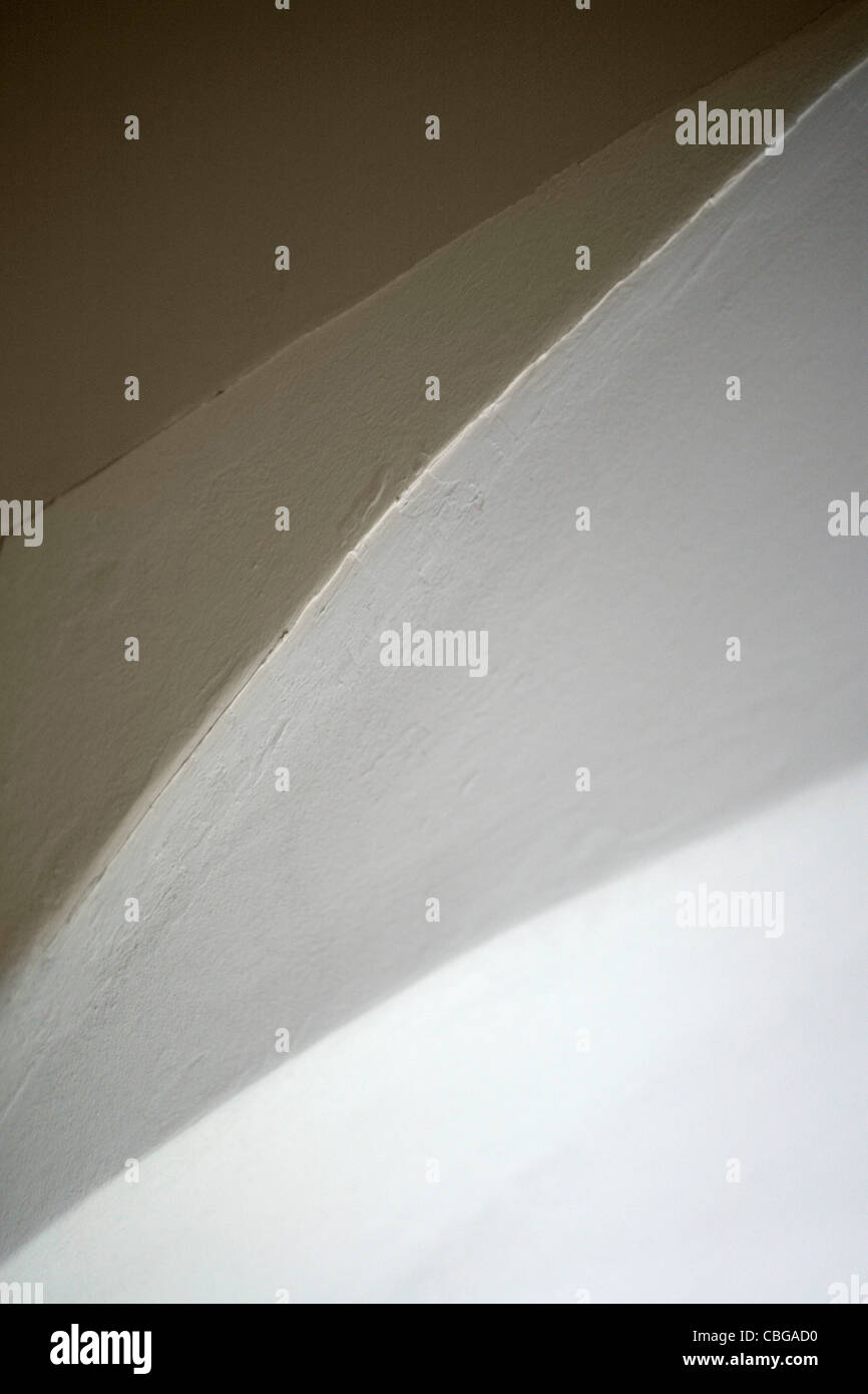 Abstract view of ceiling, wall and arch of doorway Stock Photo