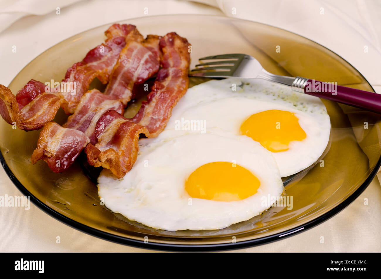 Fried Eggs and Bacon - Stock Image