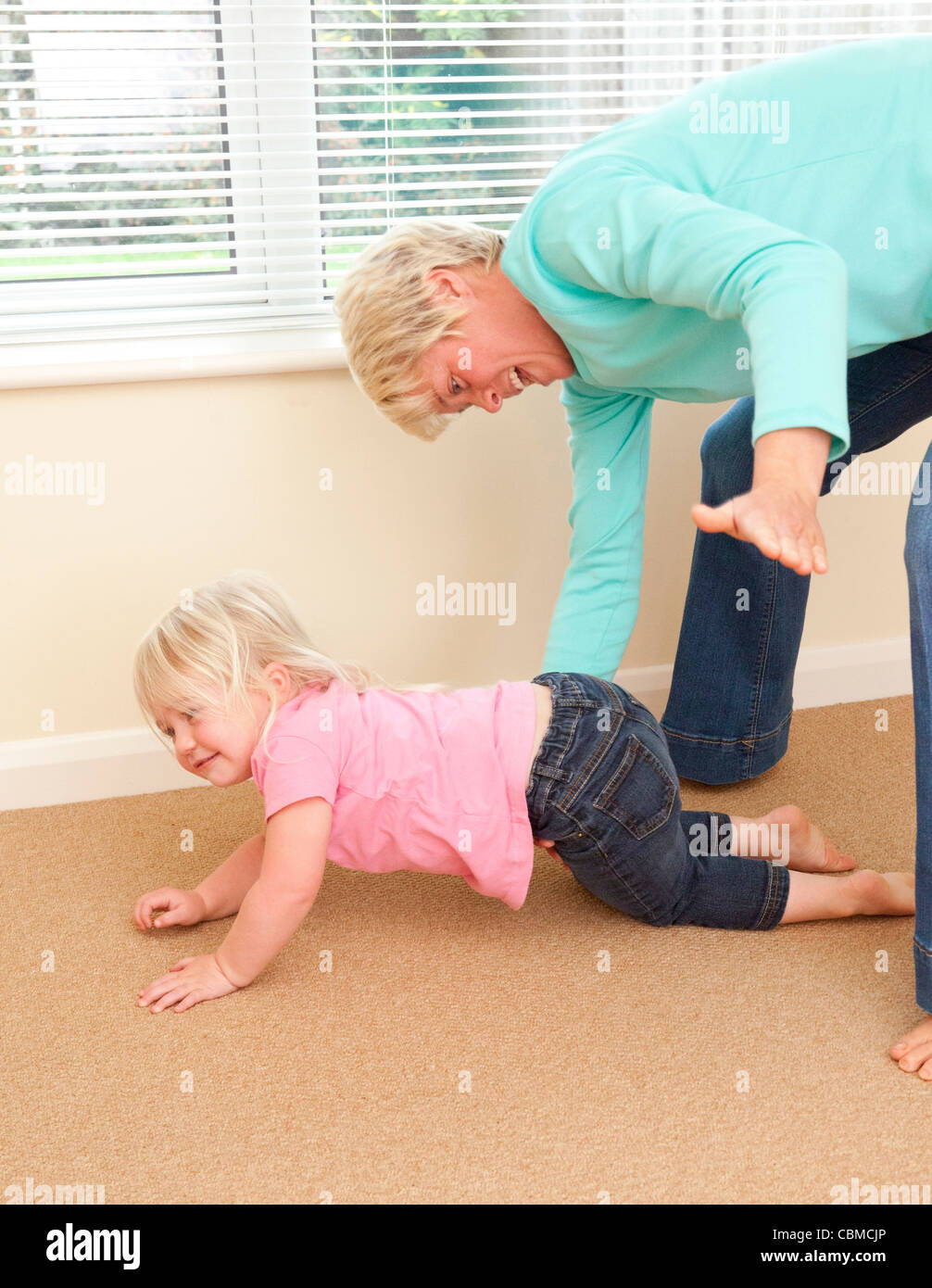mother slapping / smacking daughter as punishmentStock Photo