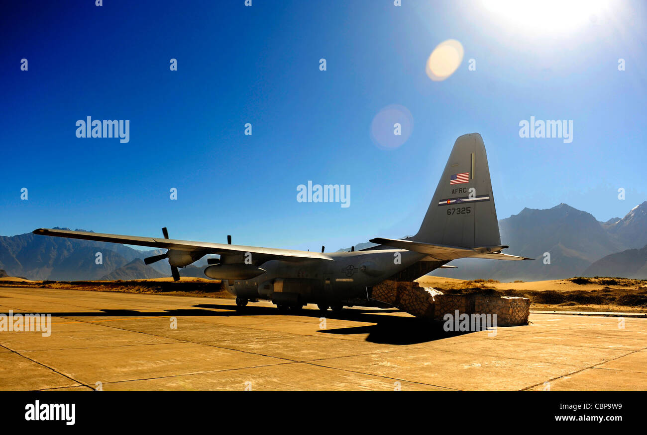 A C-130 Hercules is positioned to unload humanitarian aid supplies Oct. 3, 2010, at Skardu Airfield, Pakistan. U.S. - Stock Image