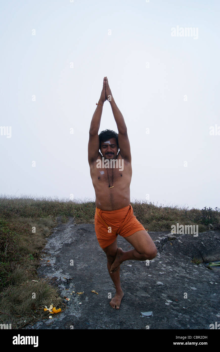 A Saint Praying god on the very top of Agastyarkoodam Peak - Stock Image