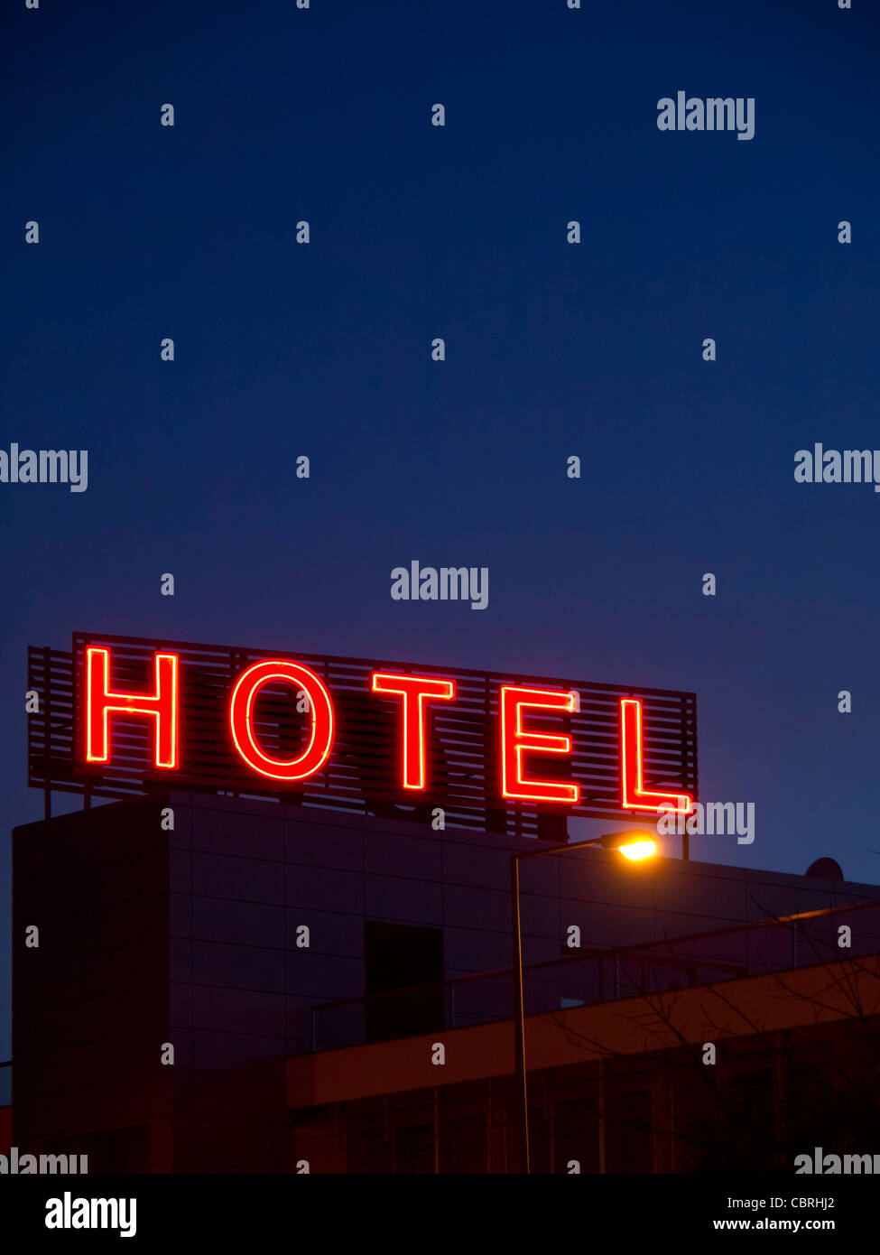 Hotel neon sign by night - Stock Image